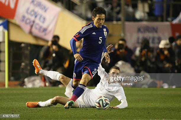 Yuto Nagatomo of Japan steals the ball from Chris James of New Zealand during the Kirin Challenge Cup international friendly match between Japan and...