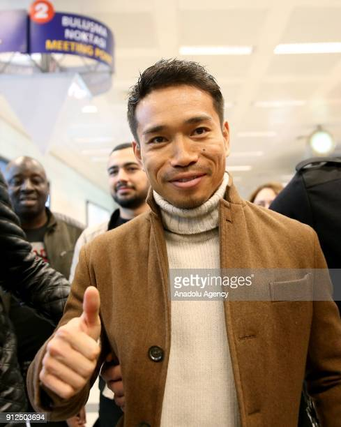 Yuto Nagatomo poses for a photo as he arrives at Ataturk International Airport in Istanbul Turkey to sign a contract with Galatasaray to complete his...
