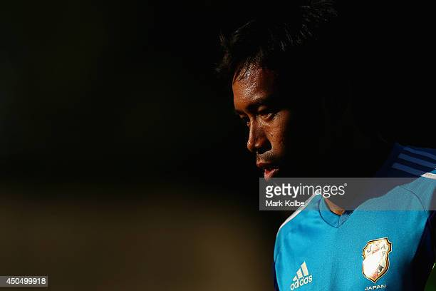Yuto Nagatomo watches on during a Japan training session at the Japan national team base camp at the Spa Sport Resort on June 12 2014 in Itu Sao Paulo