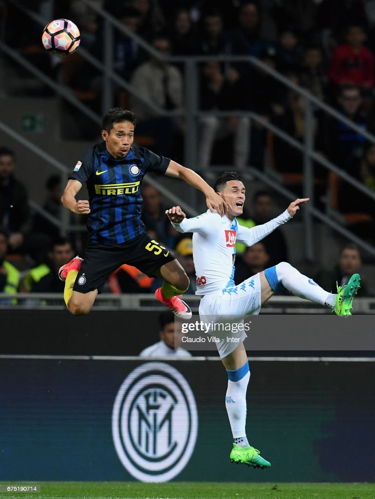 Yuto Nagatomol of FC Internazionale (L) in action during the Serie A match between FC Internazionale and SSC Napoli at Stadio Giuseppe Meazza on April 30, 2017 in Milan, Italy.