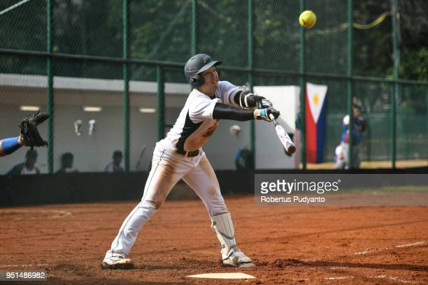 Yuto Nakajima of Japan bats during the qualification match between Japan and Philippines in the 10th Asian Men's Softball Championship on April 26...