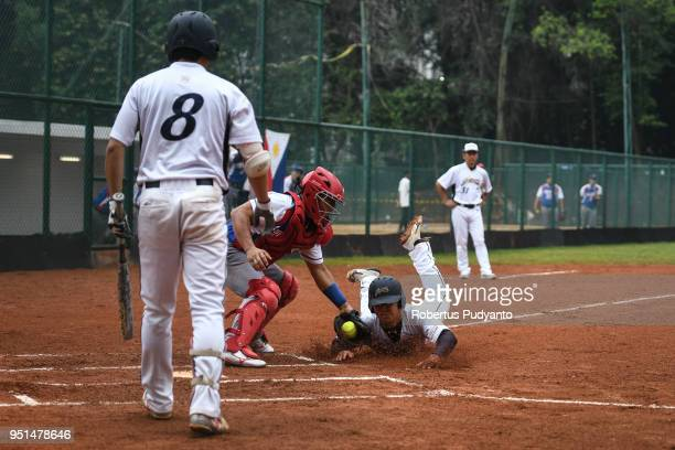 Yuto Nakajima of Japan slides during the qualification match between Japan and Philippines in the 10th Asian Men's Softball Championship on April 26...