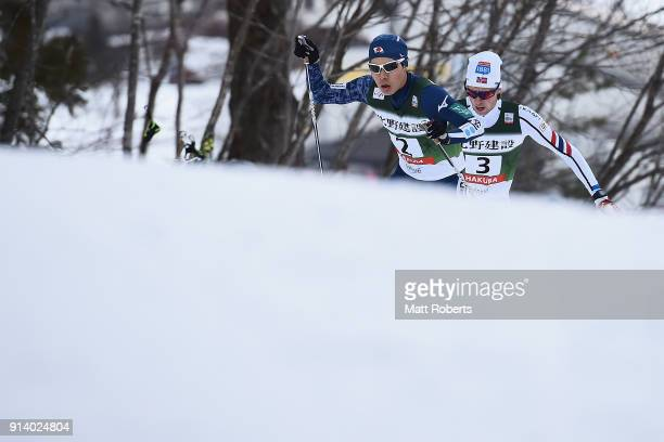 Yuto Nakamura of Japan and Harald Johnas Riiber of Norway compete in the Individual Gundersen LH/10km during day two of the FIS Nordic Combined World...