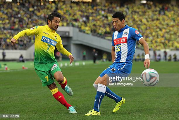 Yuto Sato of JEF United Chiba and Kim ByeomYong of Montedio Yamagata compete for the ball during the J1 Promotion PlayOff Final match between JEF...