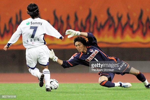 Yuto Sato of JEF United Chiba and Takashi Kitano of Albirex Niigata compete for the ball during the JLeague Yamazaki Nabisco Cup Group C match...
