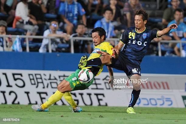 Yuto Sato of JEF United Chiba and Toshihiro Matsushita of Yokohama FC compete for he ball during the JLeague second division match between Yokohama...