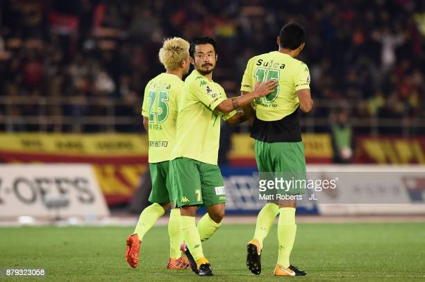 Yuto Sato of JEF United Chiba consoles his team mates Yusuke Higa and Andrew Kumagai during the JLeague J1 Promotion PlayOff semi final match between...