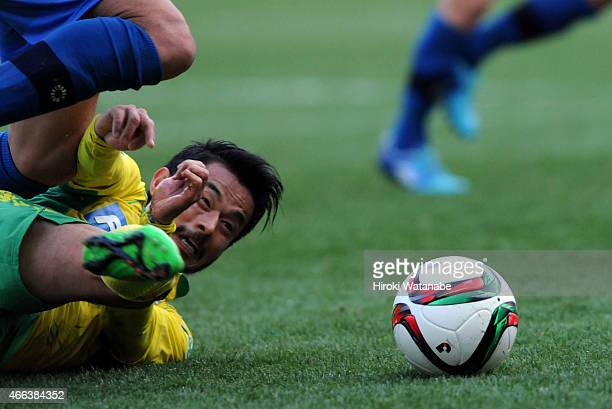 Yuto Sato of JEF United Chiba is brought down during the JLeague second division match between JEF United Chiba and Mito Hollyhock at Fukuda Denshi...