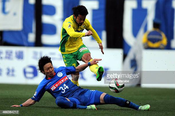 Yuto Sato of JEF United Chiba shoots while Makito Yoshida of Mito Hollyhock tries to stop during the JLeague second division match between JEF United...