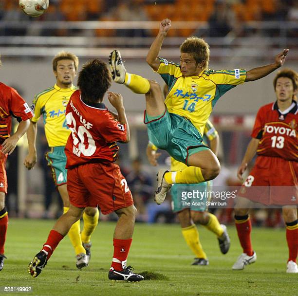 Yuto Sato of JEF United Ichihara and Ryuta Hara of Nagoya Grampus Eight compete for the ball during the JLeague match between Nagoya Grampus Eight...