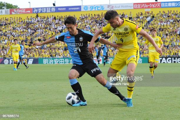 Yuto Suzuki of Kawasaki Frontale and Cristiano of Kashiwa Reysol compete for the ball during the JLeague J1 match between Kashiwa Reysol and Kawasaki...