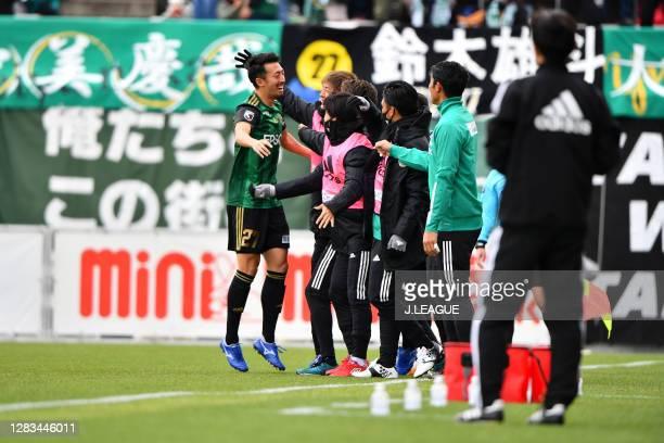Yuto SUZUKI of Matsumoto Yamaga celebrates scoring his side's first goal with his teammate during the J.League Meiji Yasuda J2 match between...