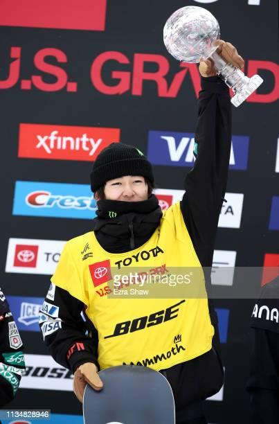 Yuto Totsuka of Japan celebrates on the podium after receiving the globe for being the overall champion for the season in the Men's Snowboard...