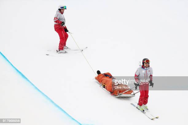 Yuto Totsuka of Japan is stretched off by medical staff after crashing in the during the Snowboard Men's Halfpipe Final on day five of the...