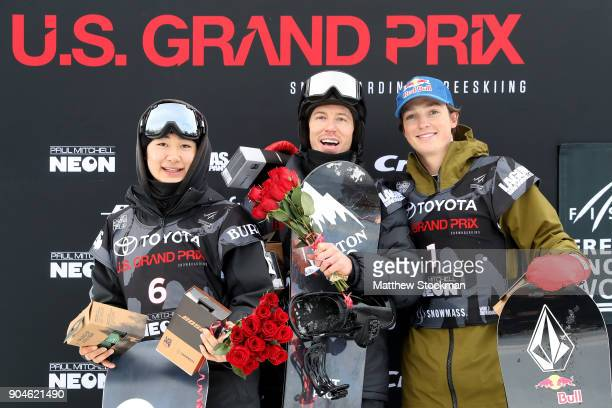 Yuto Totsuka of Japan Shaun White and Scotty James of Australia pose for photographers on the medals podium after the Men's Snowboard Halfpipe final...