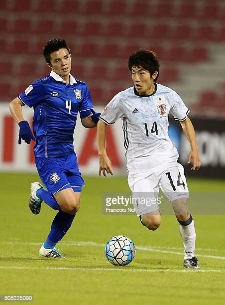 Yuto Toyokawa of Japan runs with the ball during the AFC U23 Championship Group B match between Thailand and Japan at Grand Hamad Stadium on January...