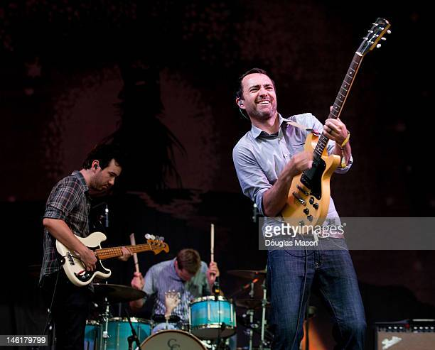 Yuuki Matthews Joe Plummer and James Mercer of The Shins perform during the 2012 Bonnaroo Music and Arts Festival on June 10 2012 in Manchester...