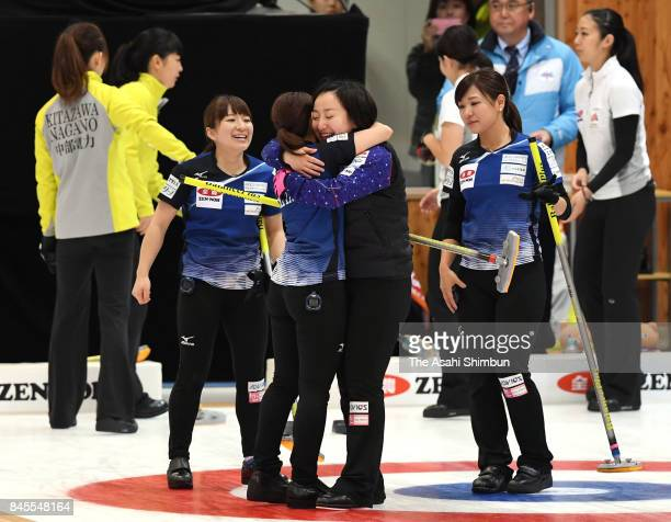 Yuumi Suzuki, Yurika Yoshida, Satsuki Fujisawa and Chinami Yoshida of LS Kitami celebrate after Game four of the Japan Women's Curling Olympic...