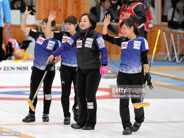 Yuumi Suzuki, Yurika Yoshida, Satsuki Fujisawa and Chinami Yoshida of LS Kitami applaud supporters after Game four of the Japan Women's Curling...