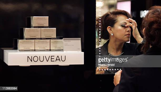 Yuvitkza Quinones sales person for Chanel checks her eyelash as she and other store employees prepare for the grand opening of a Nordtrom store in...