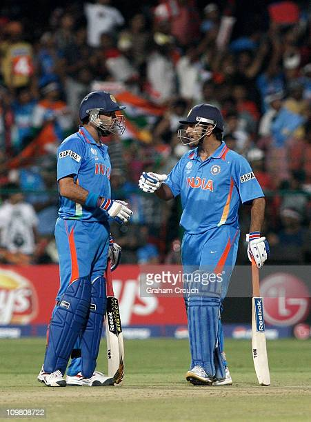 Yuvraj Singh and MS Dhoni of India during the Group B 2011 ICC World Cup match between India and Ireland at M Chinnaswamy Stadium on March 6 2011 in...