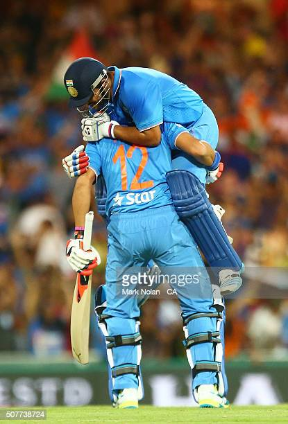 Yuvraj Singh and Suresh Raina of India celebrate winning the International Twenty20 match between Australia and India at Sydney Cricket Ground on...