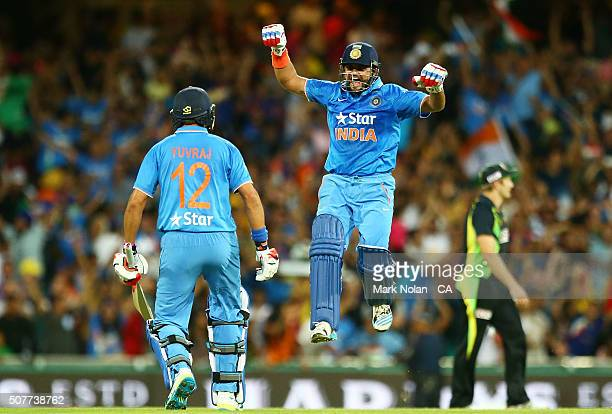 Yuvraj Singh and Suresh Raina of India celebrate winning the International Twenty20 match between Australia and India at Sydney Cricket Ground on...