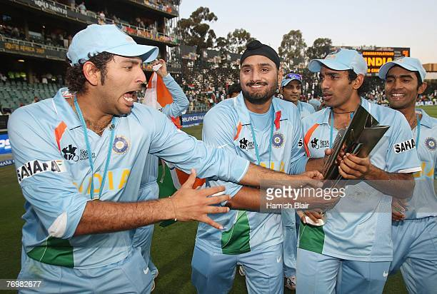 Yuvraj Singh, Harbhajan Singh and Robin Uthappa of India celebrate with the trophy after the Twenty20 Championship Final match between Pakistan and...