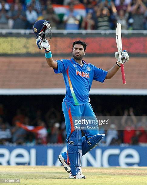 Yuvraj Singh of India acknowledges his century batting during the Group B ICC World Cup match between India and West Indies at M A Chidambaram...