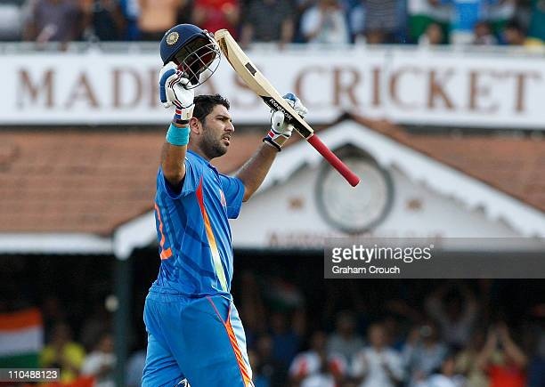 Yuvraj Singh of India acknowledges his century batting during the Group B ICC World Cup match between India and West Indies at M. A. Chidambaram...