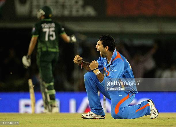 Yuvraj Singh of India celebrates after taking the wicket of Younis Khan of Pakistan during the 2011 ICC World Cup second Semi-Final between Pakistan...