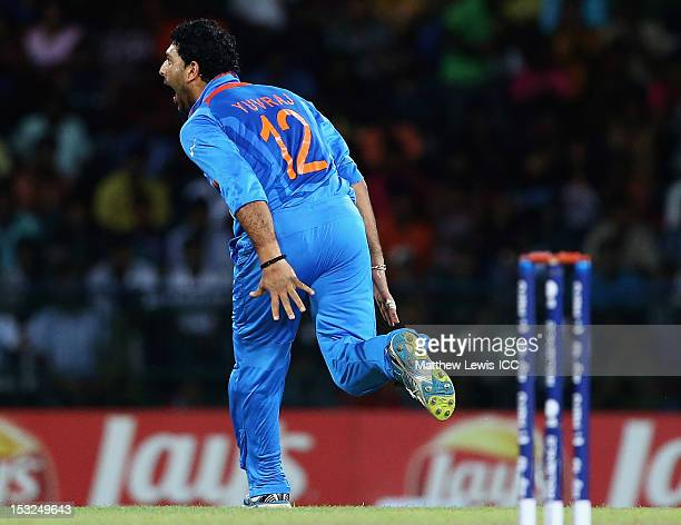 Yuvraj Singh of India celebrates bowling AB de Villiers of South Africa during the ICC World Twenty20 2012 Super Eights Group 2 match between India...