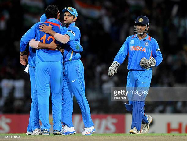 Yuvraj Singh of India celebrates the wicket of Nasir Jamshed of Pakistan with teammates Virat Kholi captain M S Dhoni and Suresh Raina during the ICC...