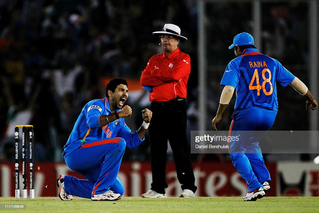 Yuvraj Singh of India celebrates with team mate Suresh Raina after taking the wicket of Younus Khan of Pakistan during the 2011 ICC World Cup second Semi-Final between India and Pakistan at Punjab Cricket Association (PCA) Stadium on March 30, 2011 in Mohali, India.