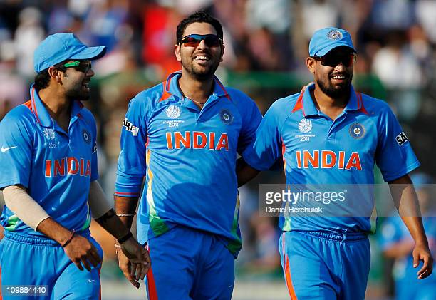 Yuvraj Singh of India celebrates with teammates Virat Kohli and Yusuf Pathan after taking the wicket of Ryan ten Doeschate of the Netherlands during...