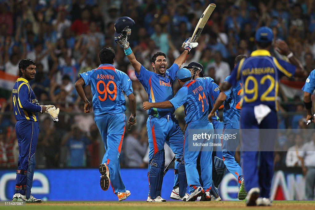 Yuvraj Singh (C) of India raises his arms after victory by six wickets during the 2011 ICC World Cup Final between India and Sri Lanka at Wankhede Stadium on April 2, 2011 in Mumbai, India.