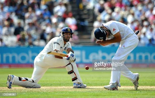 Yuvraj Singh of India smashes the ball past Alistair Cook of England during the second npower Test match between England and India at Trent Bridge on...
