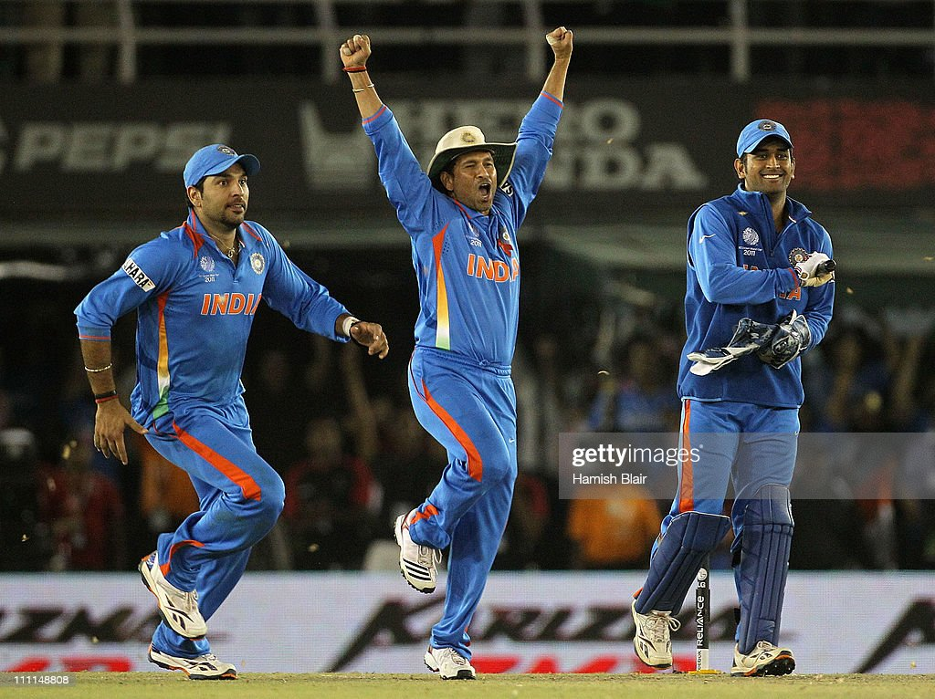 Yuvraj Singh, Sachin Tendulkar and MS Dhoni celebrate victory during the 2011 ICC World Cup second Semi-Final between Pakistan and India at Punjab Cricket Association (PCA) Stadium on March 30, 2011 in Mohali, India.