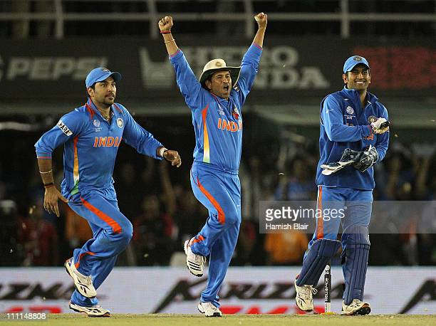 Yuvraj Singh Sachin Tendulkar and MS Dhoni celebrate victory during the 2011 ICC World Cup second SemiFinal between Pakistan and India at Punjab...