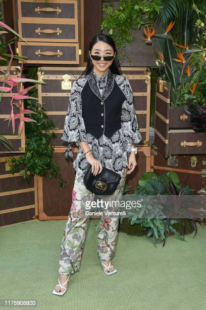 Yuwei Zhangzou attends the Etro fashion show during the Milan Fashion Week Spring/Summer 2020 on September 20 2019 in Milan Italy