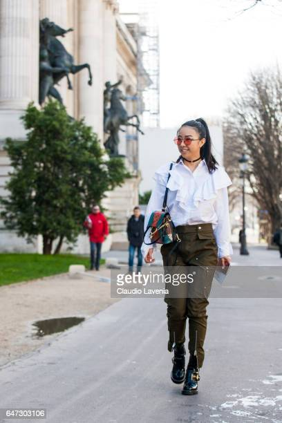 Yuwei Zhangzou is seen in the streets of Paris before the Chloe show during Paris Fashion Week Womenswear Fall/Winter 2017/2018 on March 2 2017 in...