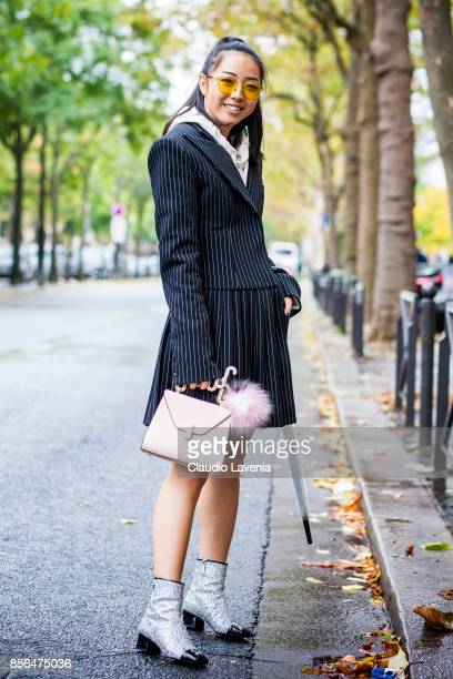 Yuwei Zhangzou is seen in the streets of Paris during Paris Fashion Week Womenswear SS18 on October 1 2017 in Paris France