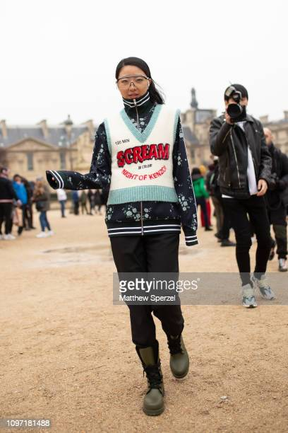 Yuwei Zhangzou is seen on the street during Men's Paris Fashion Week AW19 on January 20, 2019 in Paris, France.