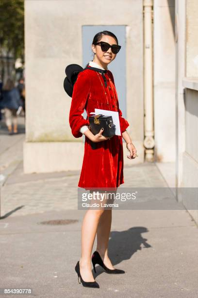 Yuwei Zhangzou is seen wearing a red dress before the Dior show at the Musee Rodin during Paris Fashion Week Womenswear SS18 on September 26 2017 in...