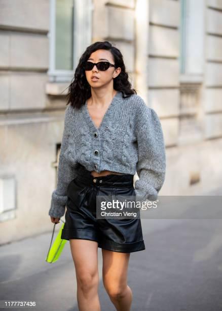 Yuwei Zhangzou is seen wearing grey cropped cardigan black leather shorts neon bag outside Alessandra Rich during Paris Fashion Week Womenswear...