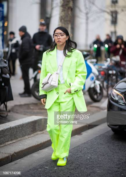 Yuwei Zhangzou is seen wearing neon suit outside Acne during Paris Fashion Week Menswear F/W 20192020 Day Six on January 20 2019 in Paris France
