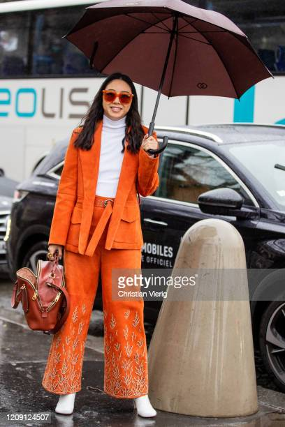 Yuwei Zhangzou is seen wearing orange jacket and pants outside Chloe during Paris Fashion Week Womenswear Fall/Winter 2020/2021 Day Four on February...