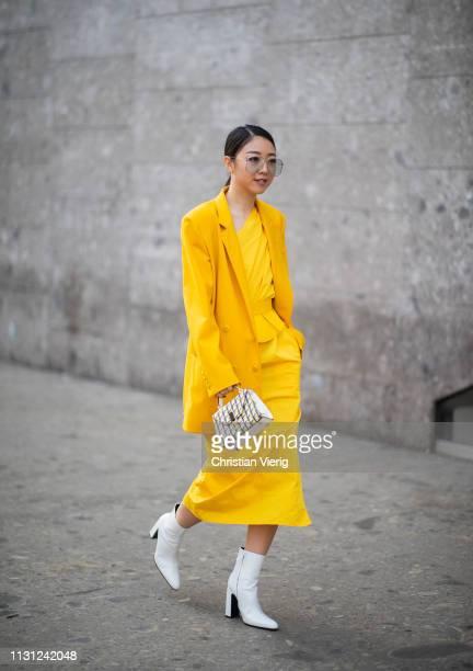 Yuwei Zhangzou is seen wearing yellow dress blazer white ankle boots mini bag outside Max Mara on Day 2 Milan Fashion Week Autumn/Winter 2019/20 on...