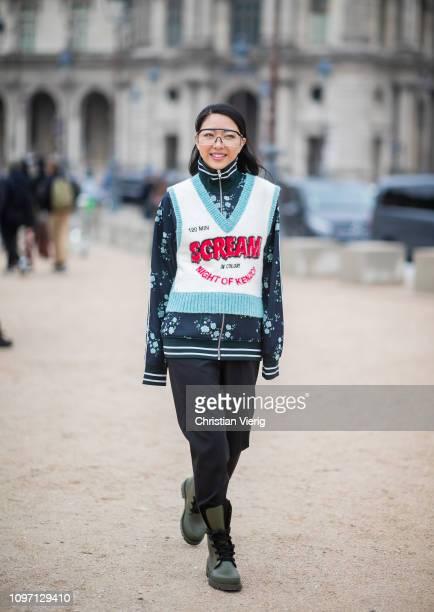 Yuwei Zhangzou is seen wearing zip jacket, sleeveless v neck knit, glasses outside Kenzo during Paris Fashion Week - Menswear F/W 2019-2020 Day Six...