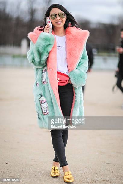 Yuwei Zhangzou is wearing a Chloe bag and Gucci shoes after the Carven show during Paris Fashion Week Womenswear Fall Winter 2016/2017 on March 3...